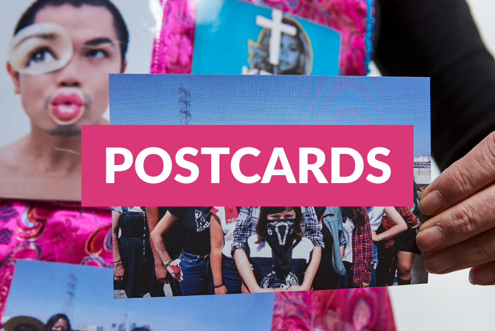 Postcards link over an image of a woman holding a postcard.