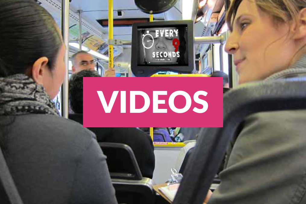 Videos link over an image of two women in a bus.